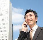 Businessman talks with a cellular phone